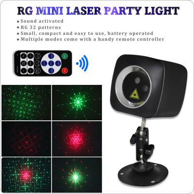 WL-513A Mini RG 32 Patterns Red / Green LED Light Effect Handheld Projector Laser Lamp with Remote Control USB Charging for Disco / DJ Club / KTV / Family Party